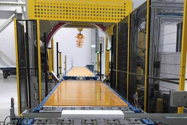 Sistemas de producción paneles sandwich – Sistemas – Máquina embaladora